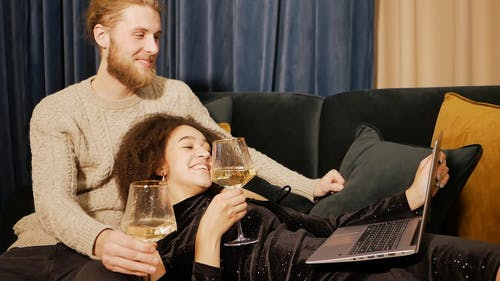 Couple Drinking Champagne while Doing a Video Call