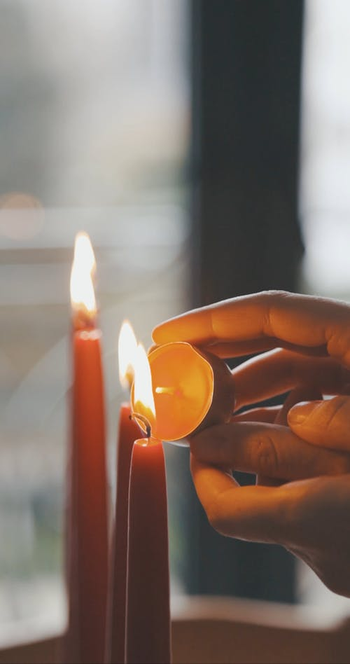 Person Lighting Small Candle