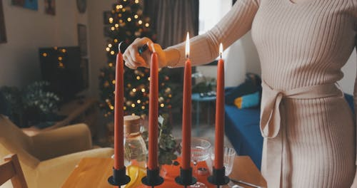 Woman Lighting the Candles