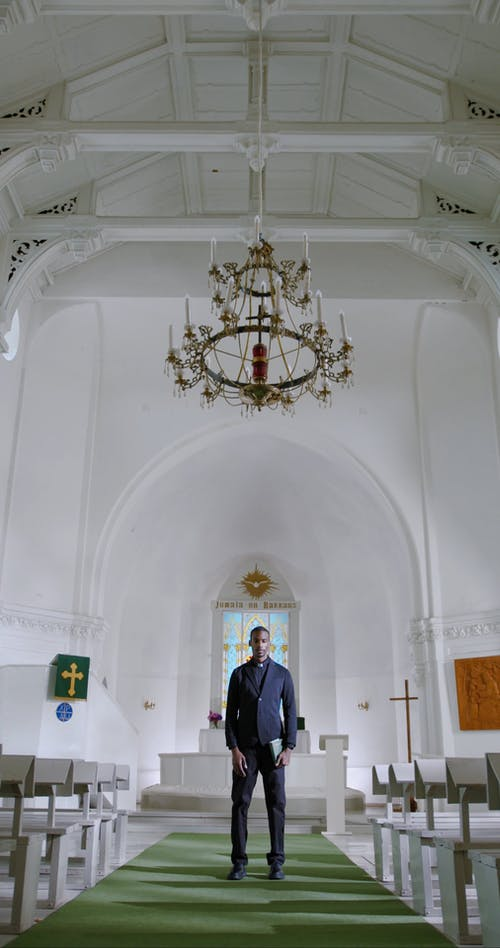 A Priest Standing at the Center of the Church