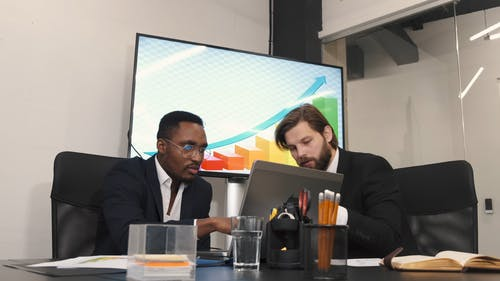 Two Men Discussing in the Office