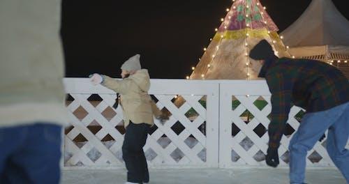 People Having Fun While Skating on Ice