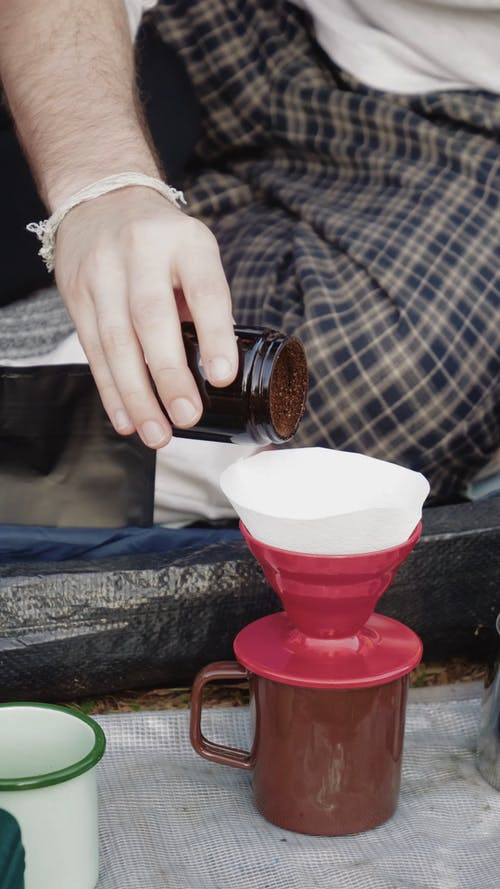 A Person Making a Cup of Coffee