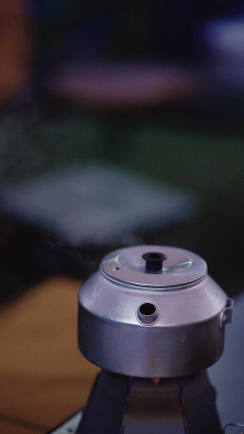 A Small Teapot on Flame