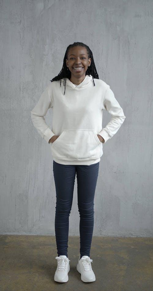 Woman In White Hoodie Posing On Camera