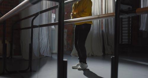 Man Dancing in Front of Mirror