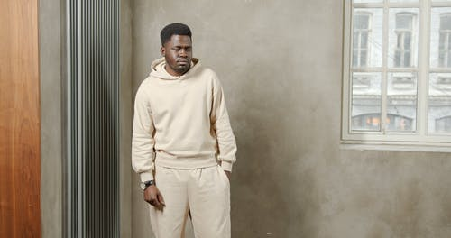 Man Posing in Beige Clothes