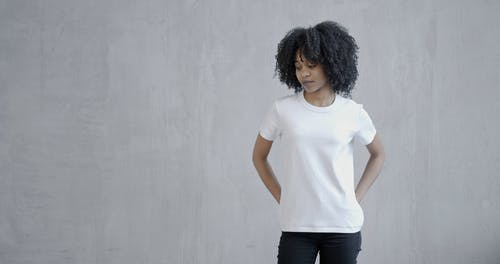 Woman in White T-shirt and Black Jeans
