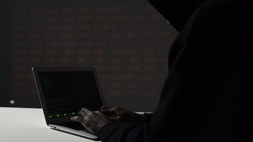 A Man Programming His Laptop