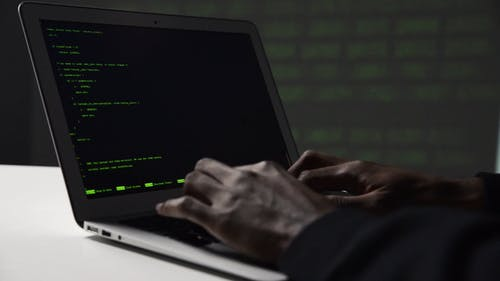 Close Up View of a Man Doing Computer Programming