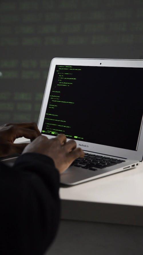 A Man Encoding on His Laptop