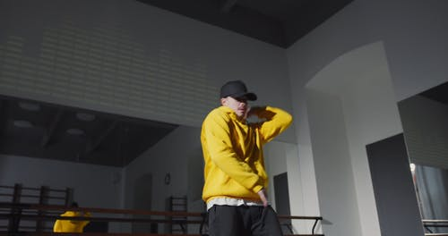 Man in Yellow Pullover Dancing