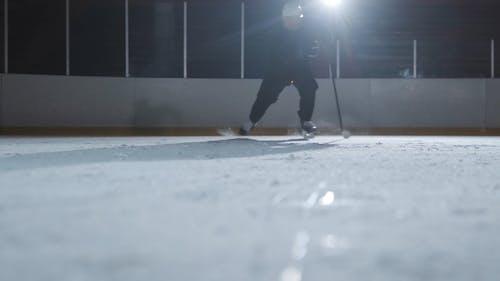 Ice Hokey Player Skating