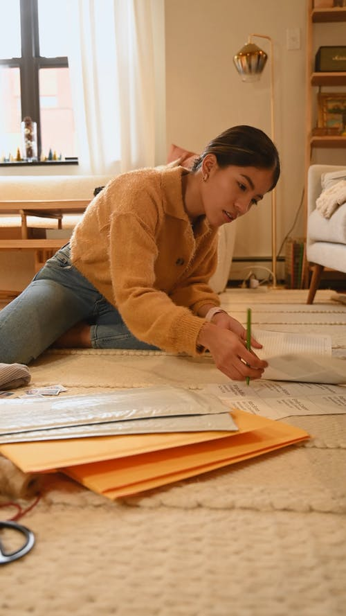 Woman Writing her Order Details in Diary