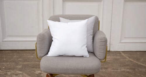 White Cushions on Gray Chair