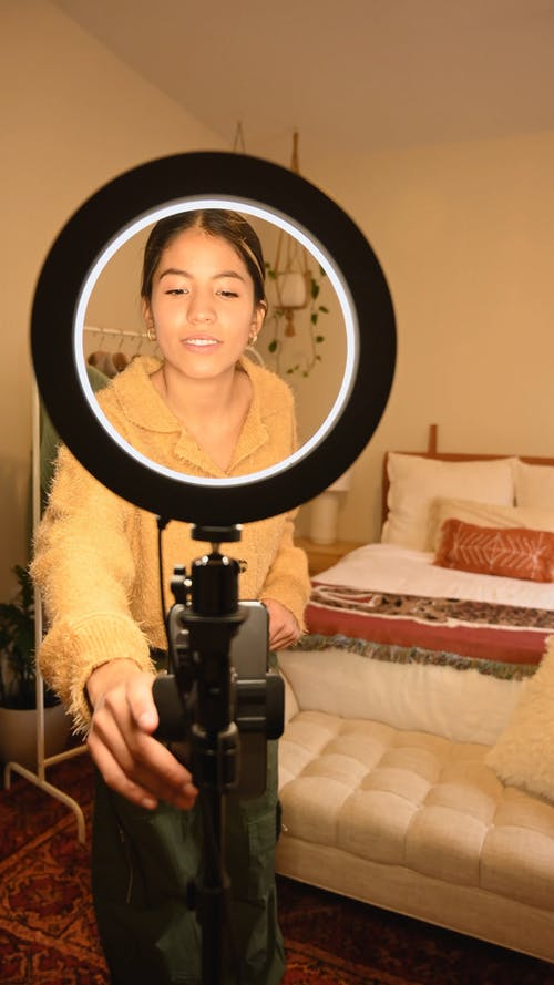 Young Woman Recording Fashion Blog
