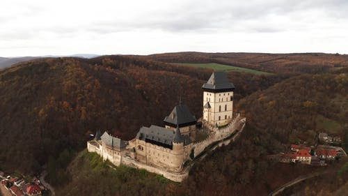 Aerial View of a Castle on Top of the Mountain