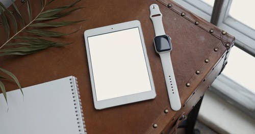High Angle Shot of Tablet and Smart Watch