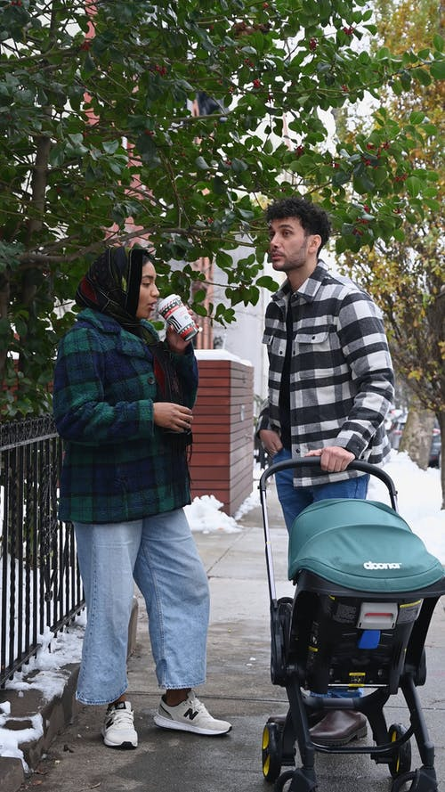 Parents with a Baby Stroller
