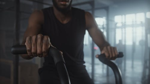A Man Exercising on a Stationary Bike