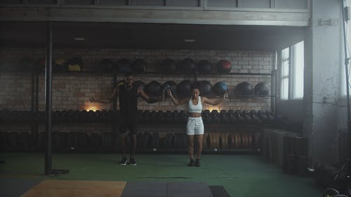 Couple Exercising using Jumping Rope