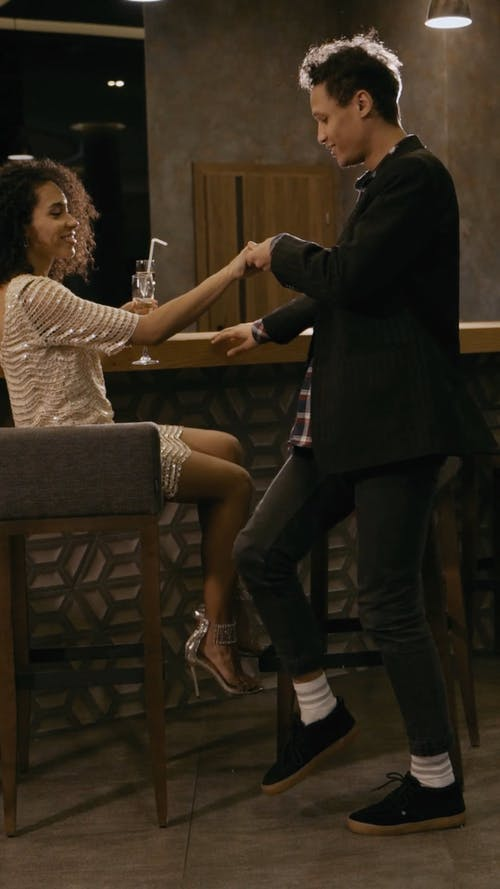 Man Assisting the Woman to Stand from her Sit