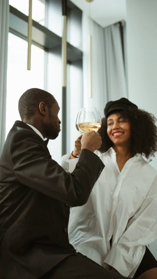Man and Woman Clinking Glass of Wine