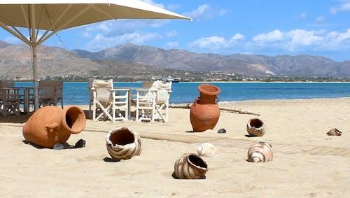 Decorative Vases on a Sandy Beach