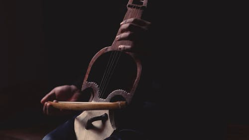 A Person Playing Stringed Instrument