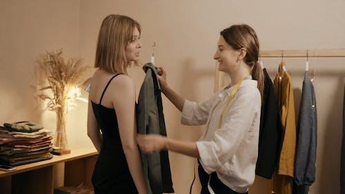 A Female Fashion Designer Showing Shirt to a Woman