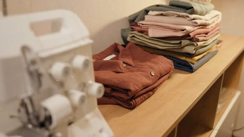 Close Up View of Garments Arranged in a Wooden Rack