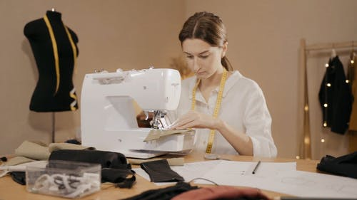 A Woman Sewing on a Sewing Machine