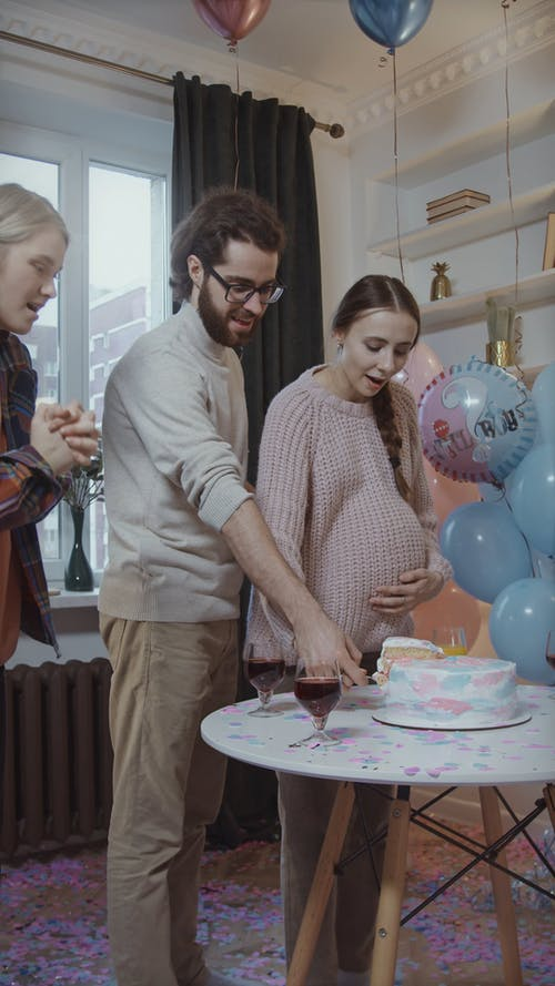 Happy People at Gender Reveal Party