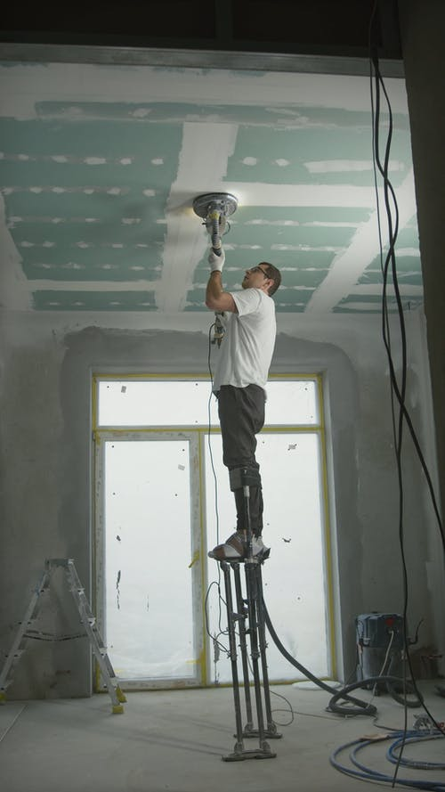A Man Working On A Ceiling