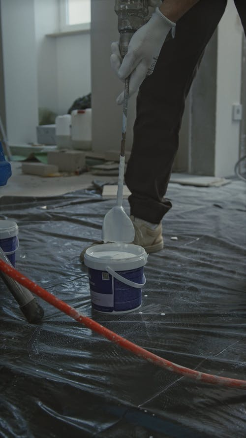 A Person Mixing the Paint