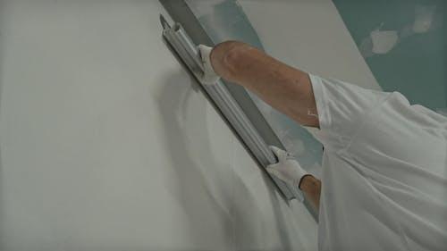 Man Applying Wall Putty