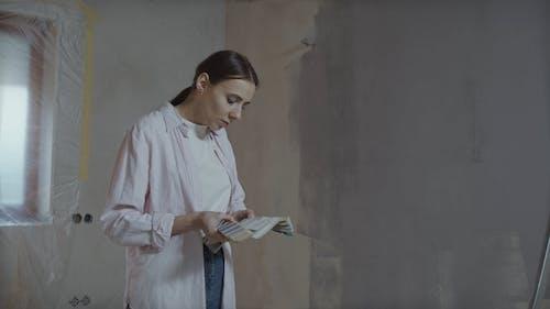 Woman Choosing Colors