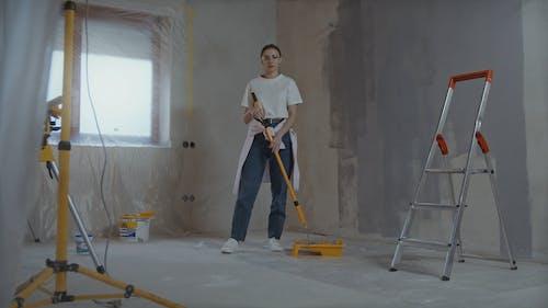 Woman Preparing to Paint