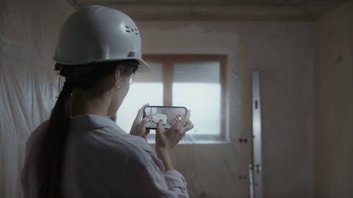 Interior Designer Using Application on Smartphone
