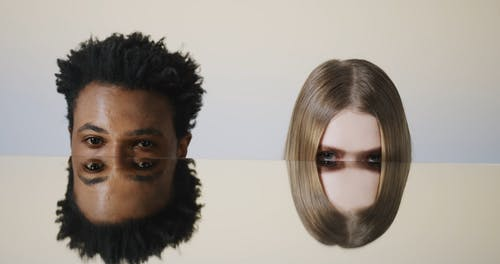 Man and Woman Showing Face Reflection