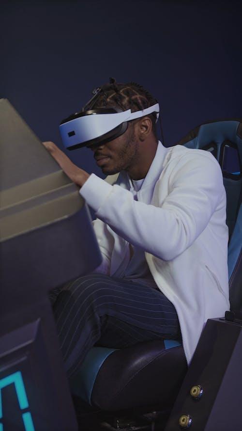 Man Playing VR Arcade Game