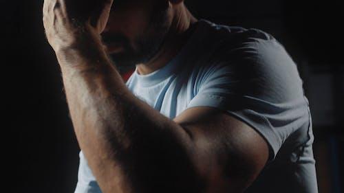 Man Wiping Sweat