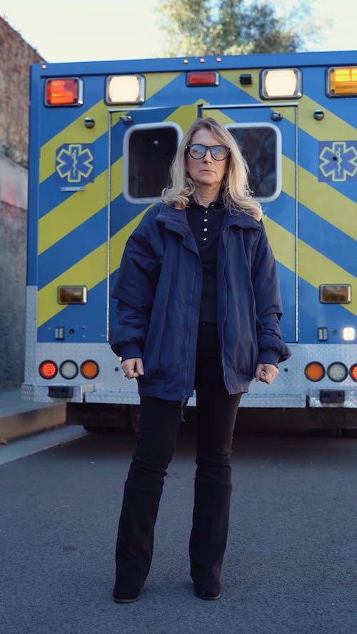 Woman Standing Near An Ambulance