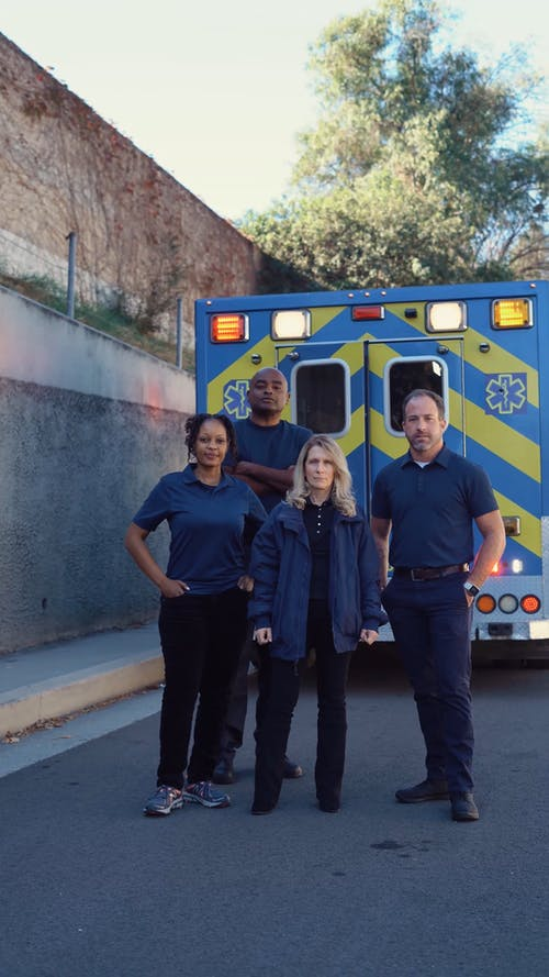 Paramedics Standing Near An Ambulance