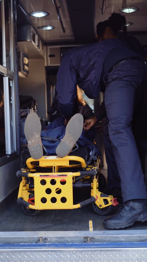 Paramedic Closing Ambulance Door