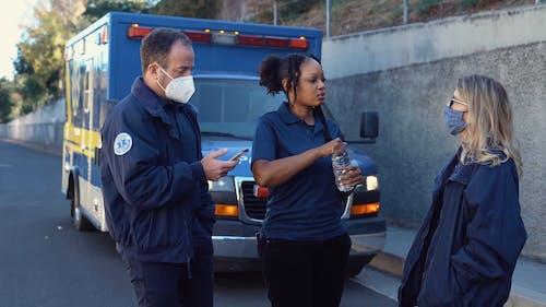 Paramedics Going Inside An Ambulance