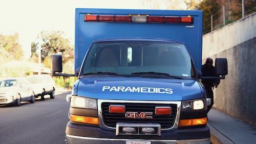 Paramedics Walking Towards The Ambulance