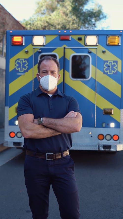 Paramedic Removing His Mask