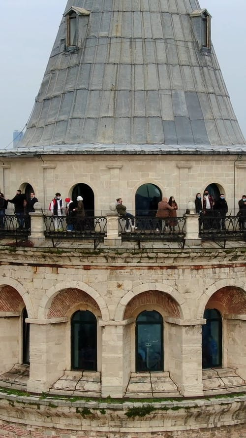 People Standing on the Tower