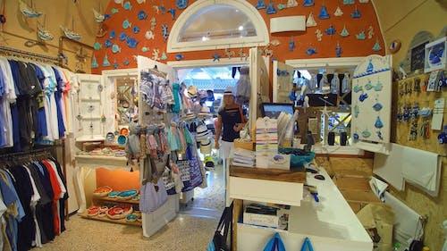Woman Looking Inside of a Souvenir Shop
